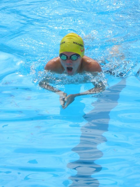 Matia McGuinniety gets a breath on his way to winning the 200 IM